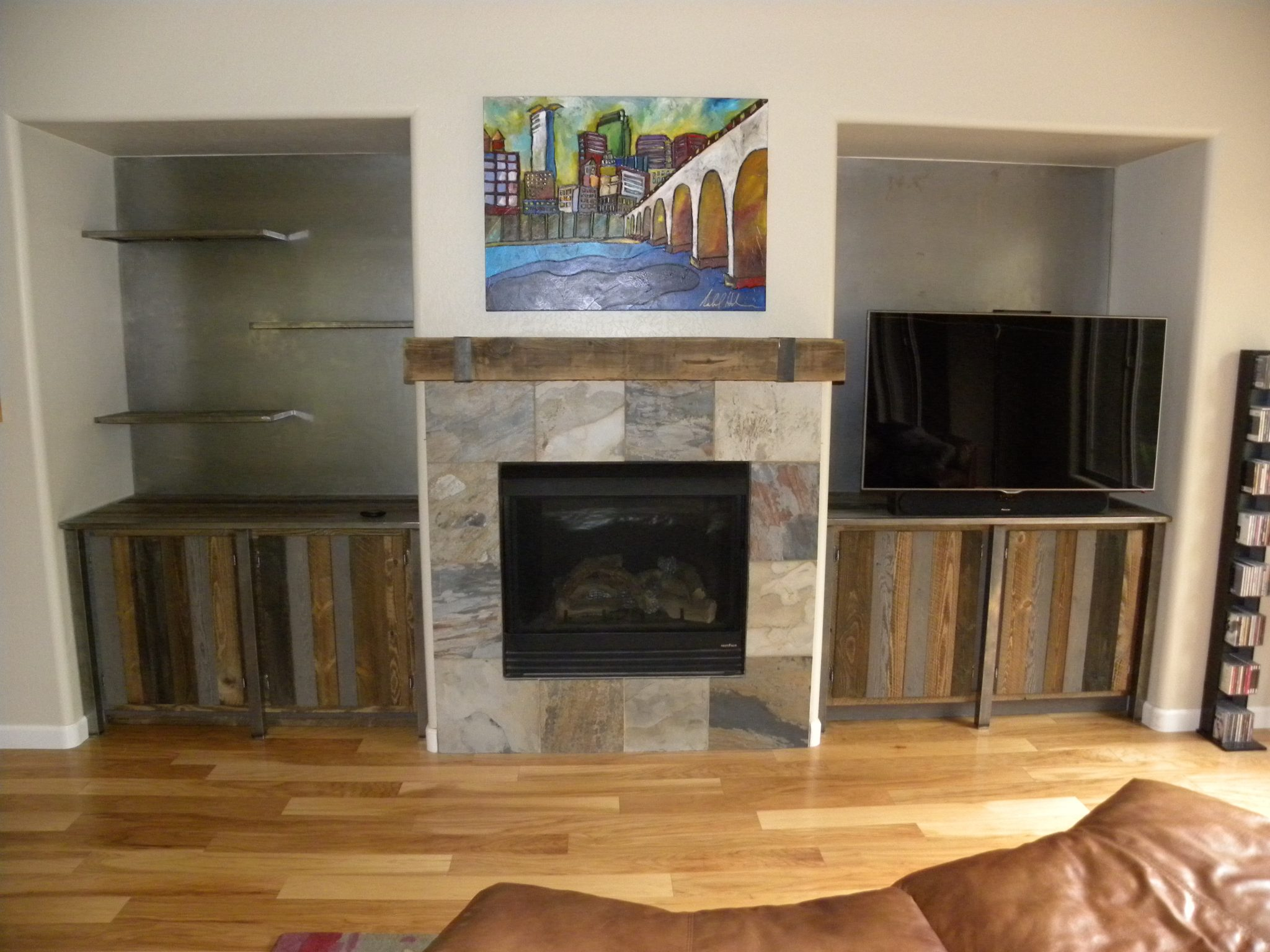 Custom designed fireplace with wood trimming