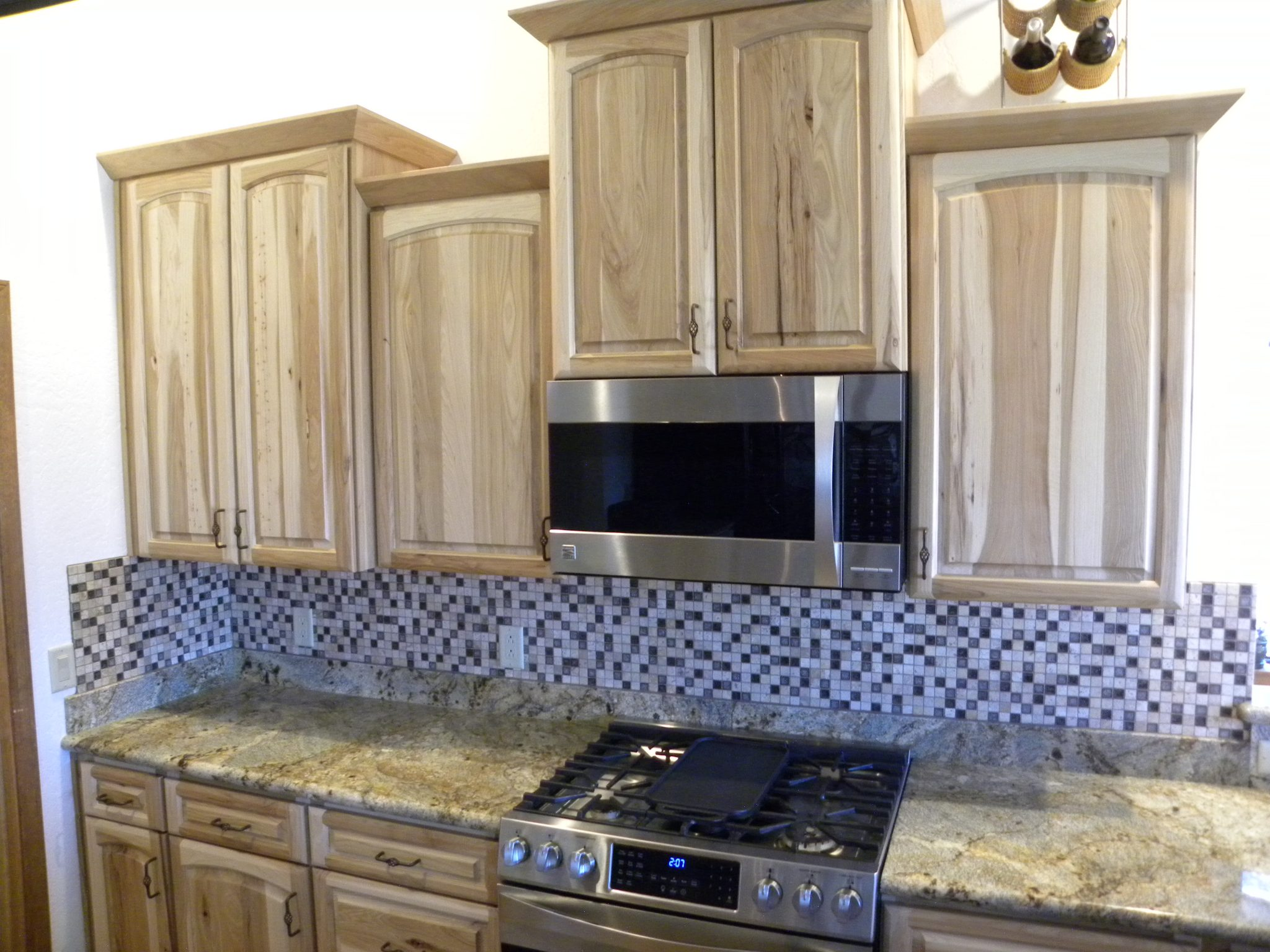 Custom designed kitchen with wooden cabinets and granite countertops