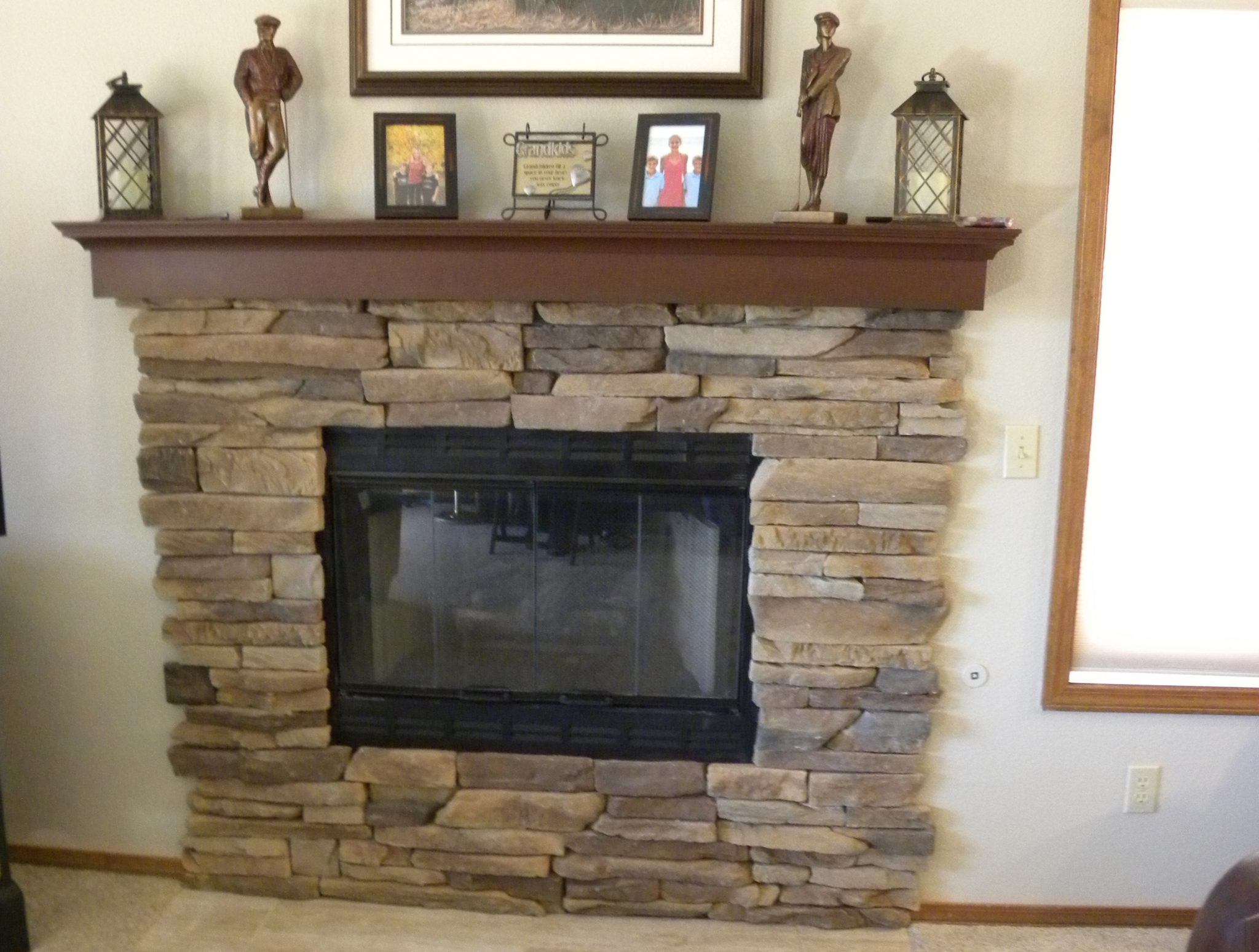 Custom designed fireplace with stone framing
