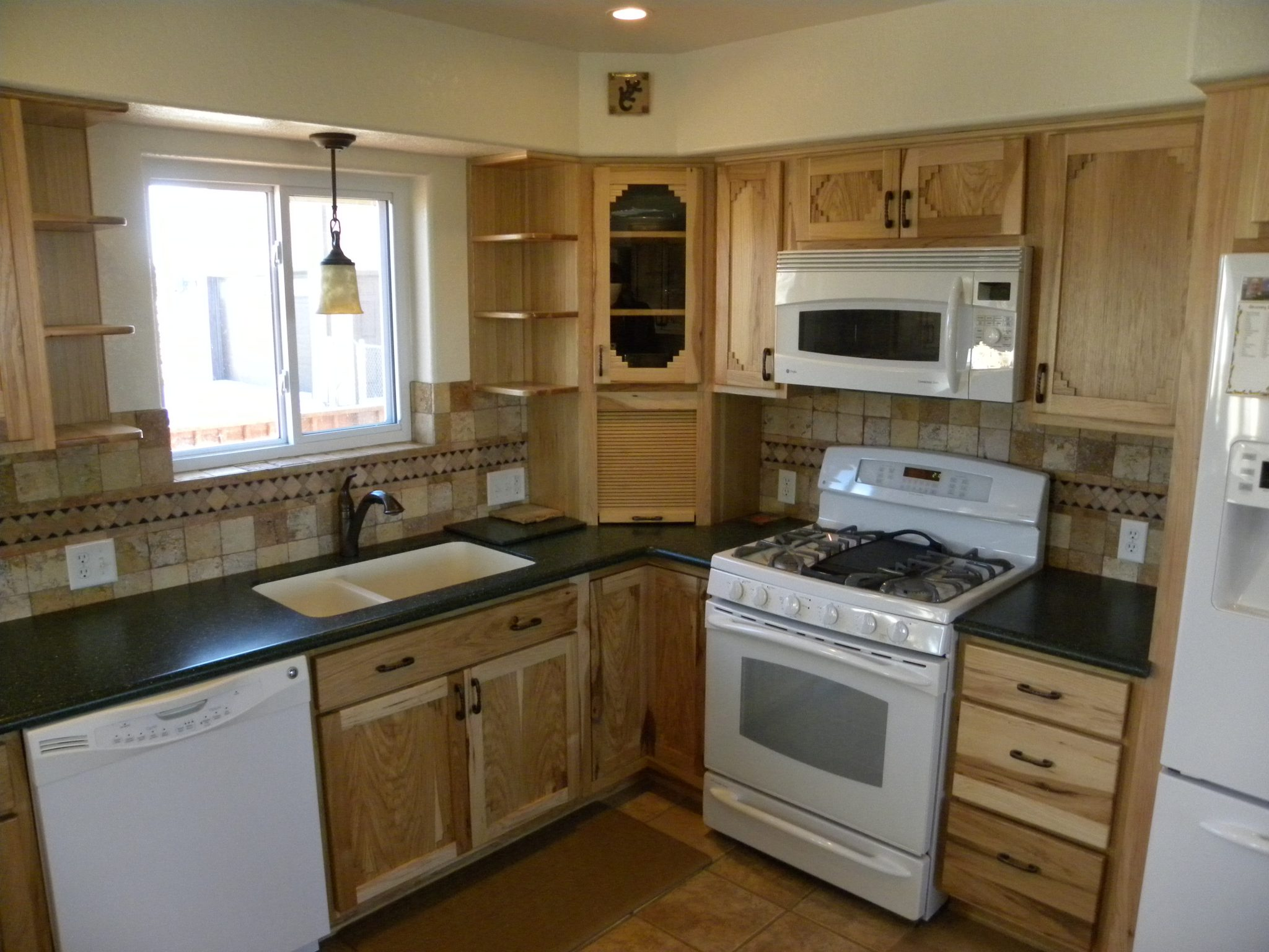newly remodeled kitchen with wooden cabinets and granite countertops - Newly Remodeled Kitchens