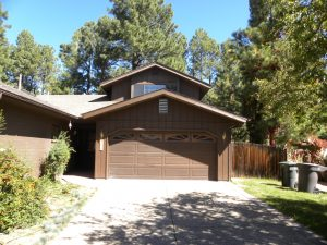 Exterior view of a two car garage that is part of a brown house