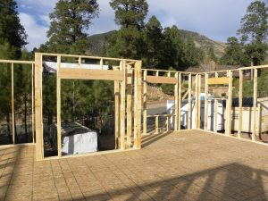 Photo from a house construction site in a forested neighborhood.