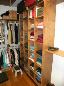 Custom designed closet space with wooden shelving
