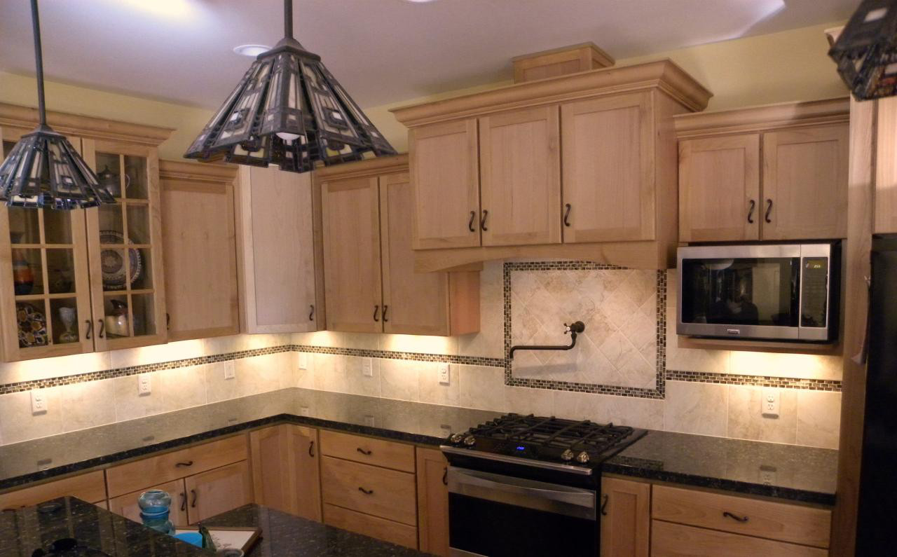 Newly remodeled kitchen with wooden cabinets and granite countertops