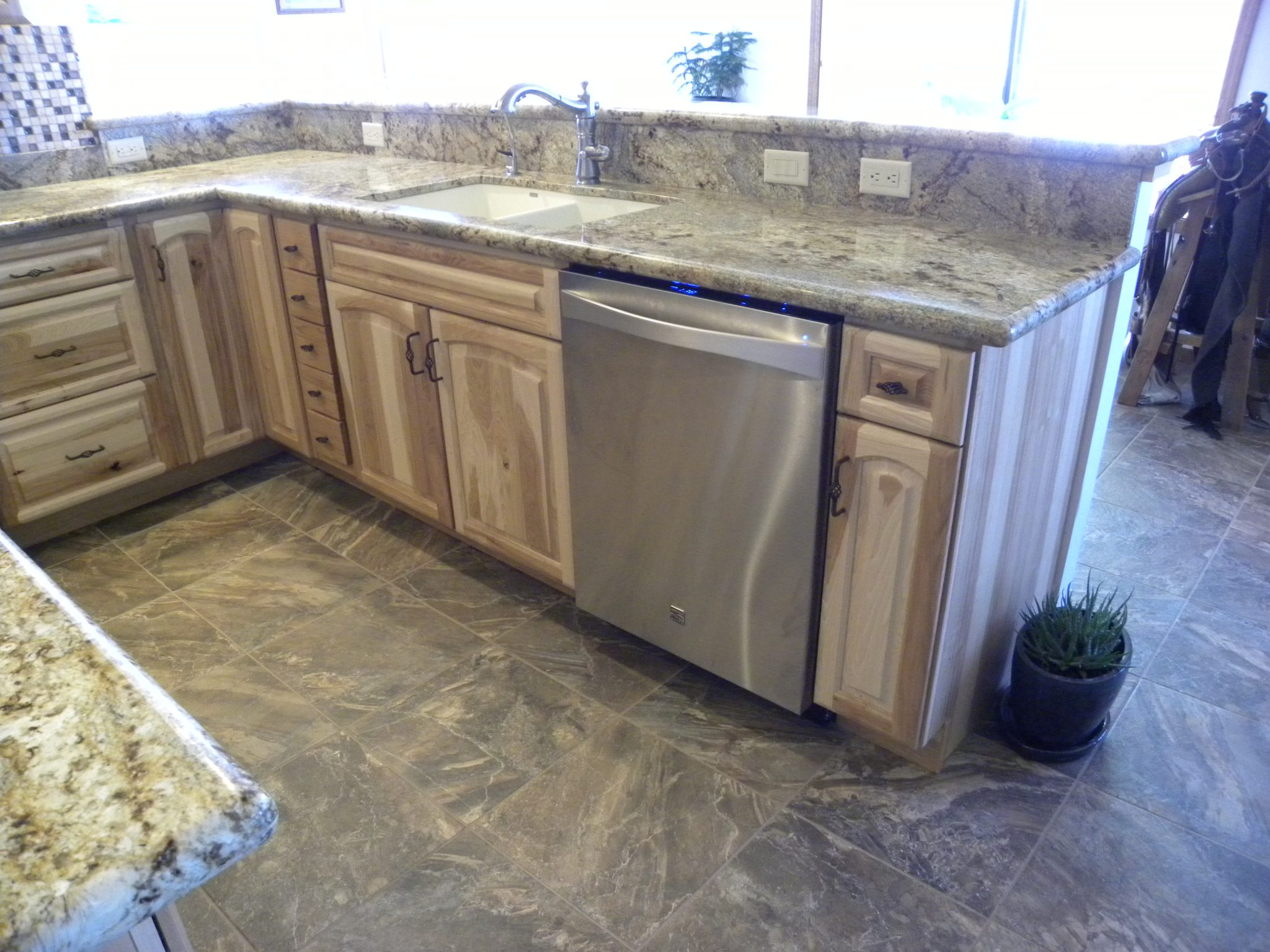 Interior shot of a newly remodeled residential home with granite countertops and custom wooden cabinets
