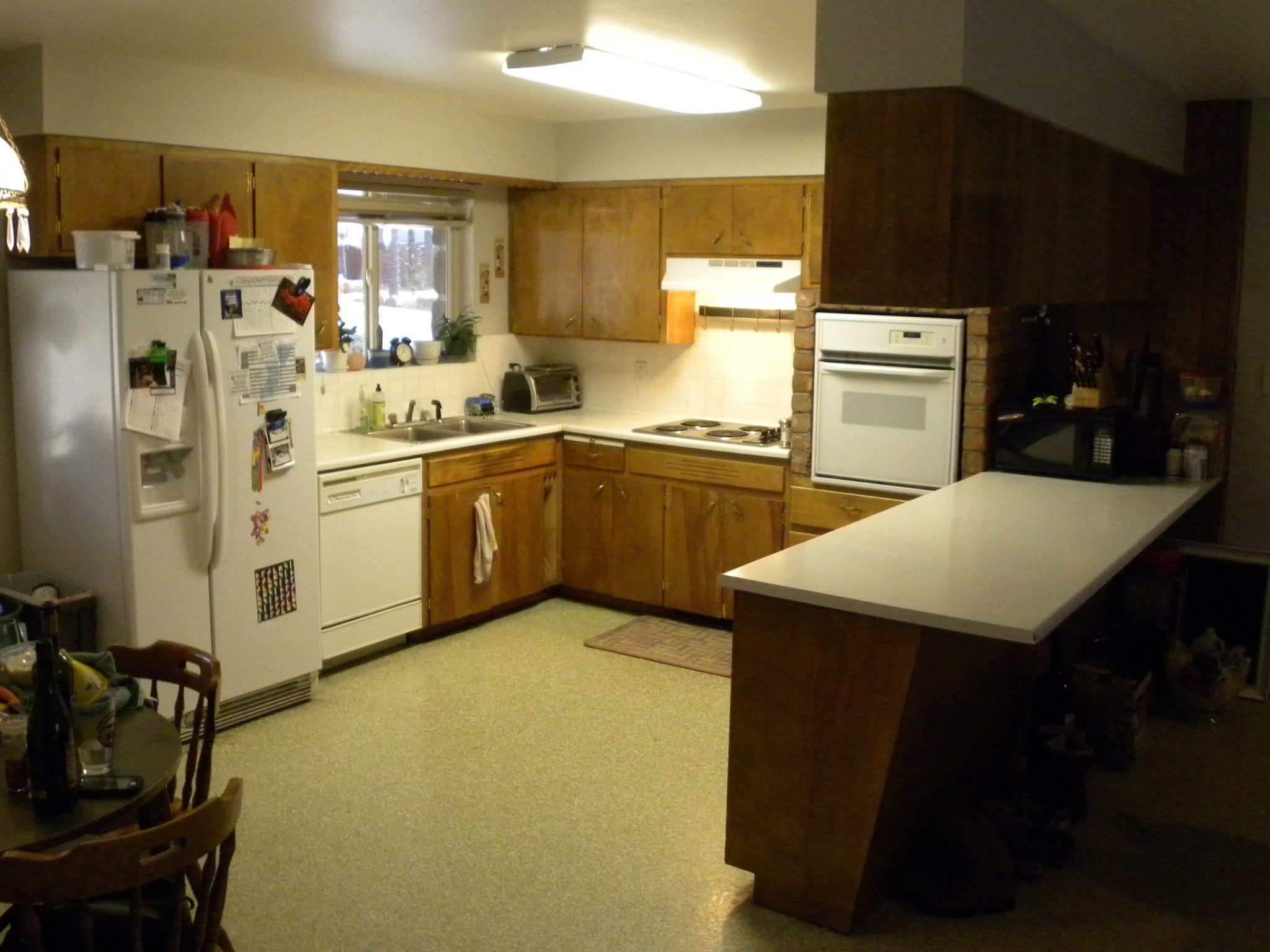 Interior shot of a residential kitchen in need to remodeling