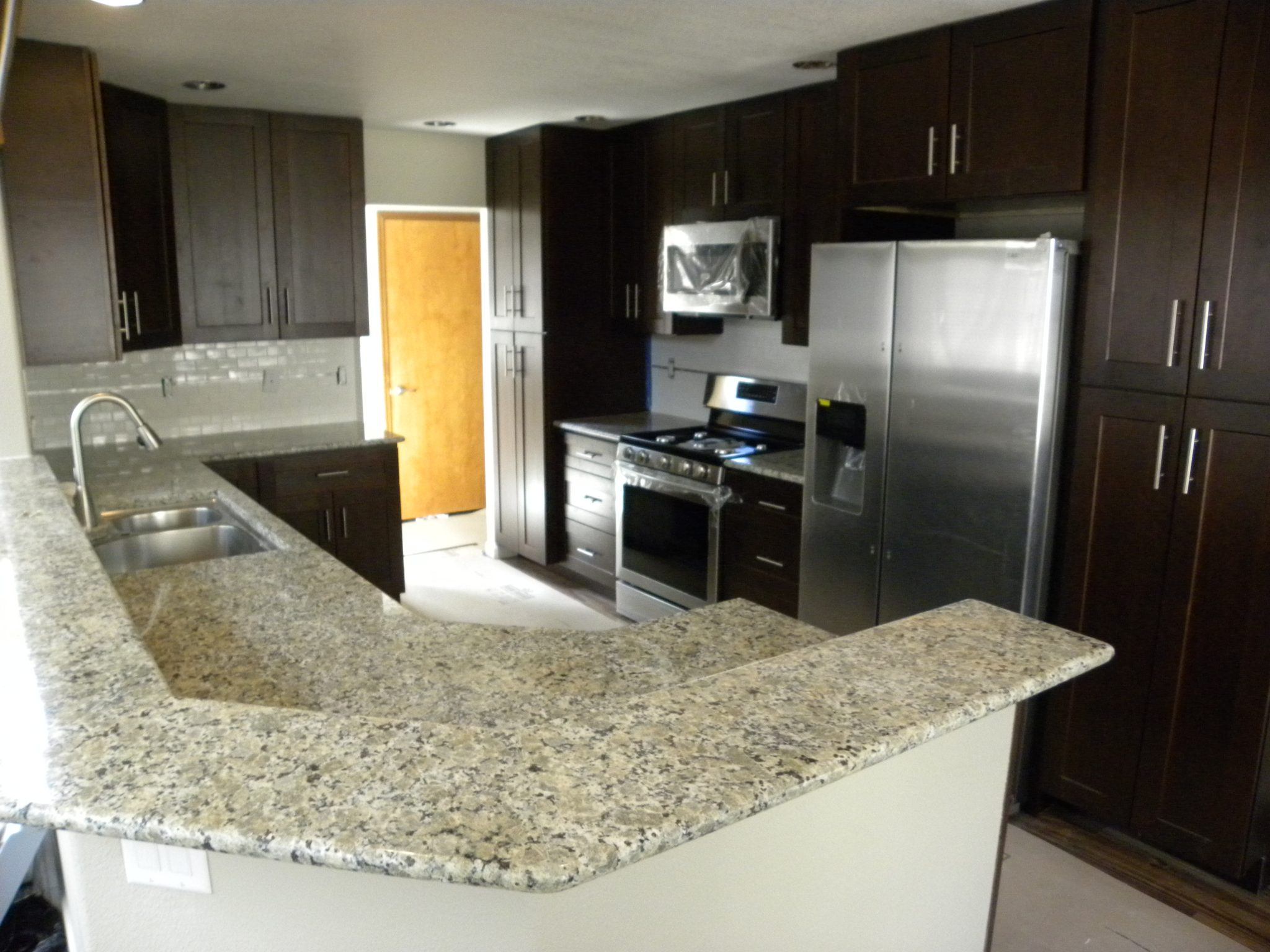 Newly remodeled kitchen with granite countertops and wooden cabinets