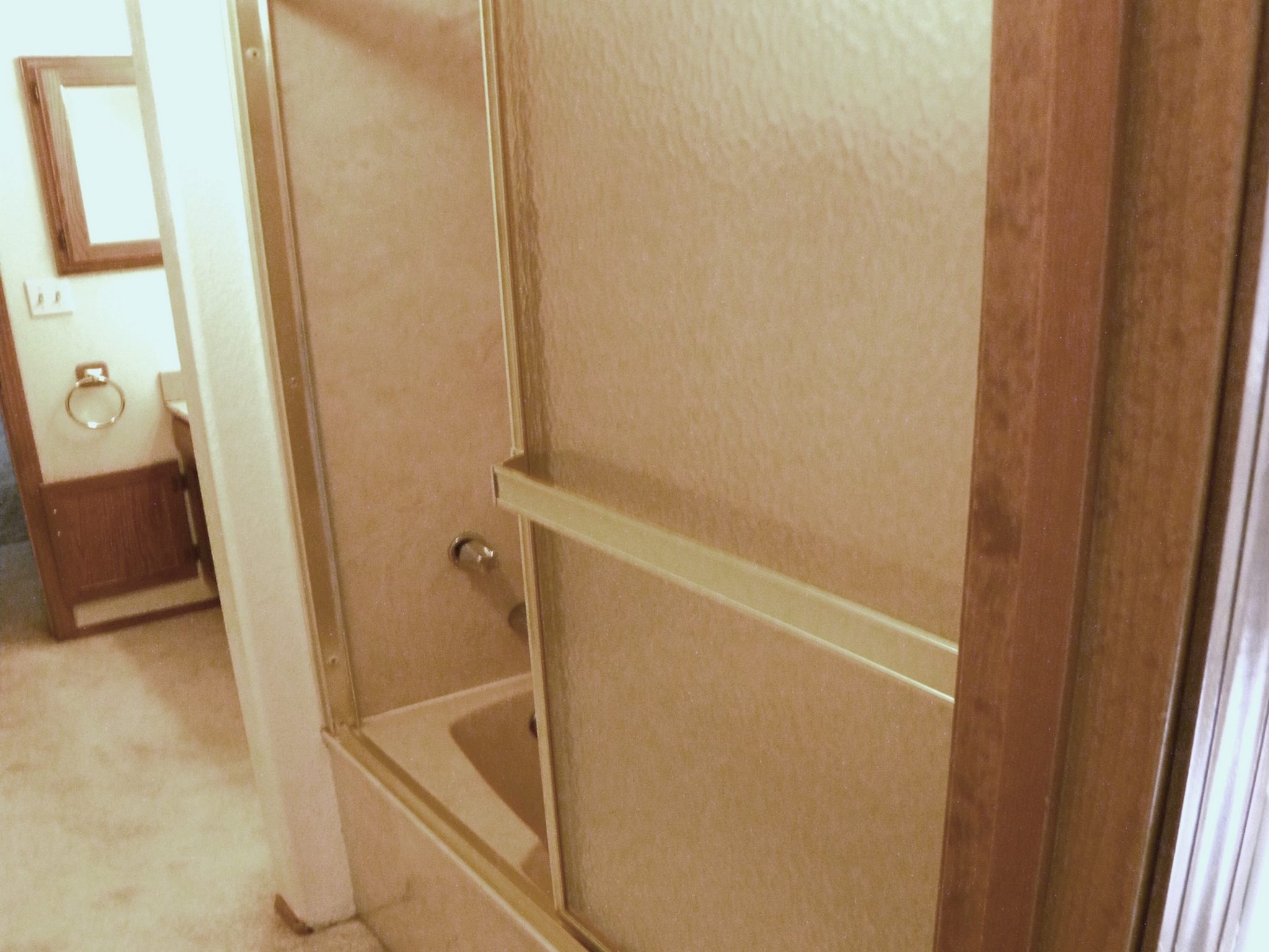 Interior before shot of a residential bathroom shower