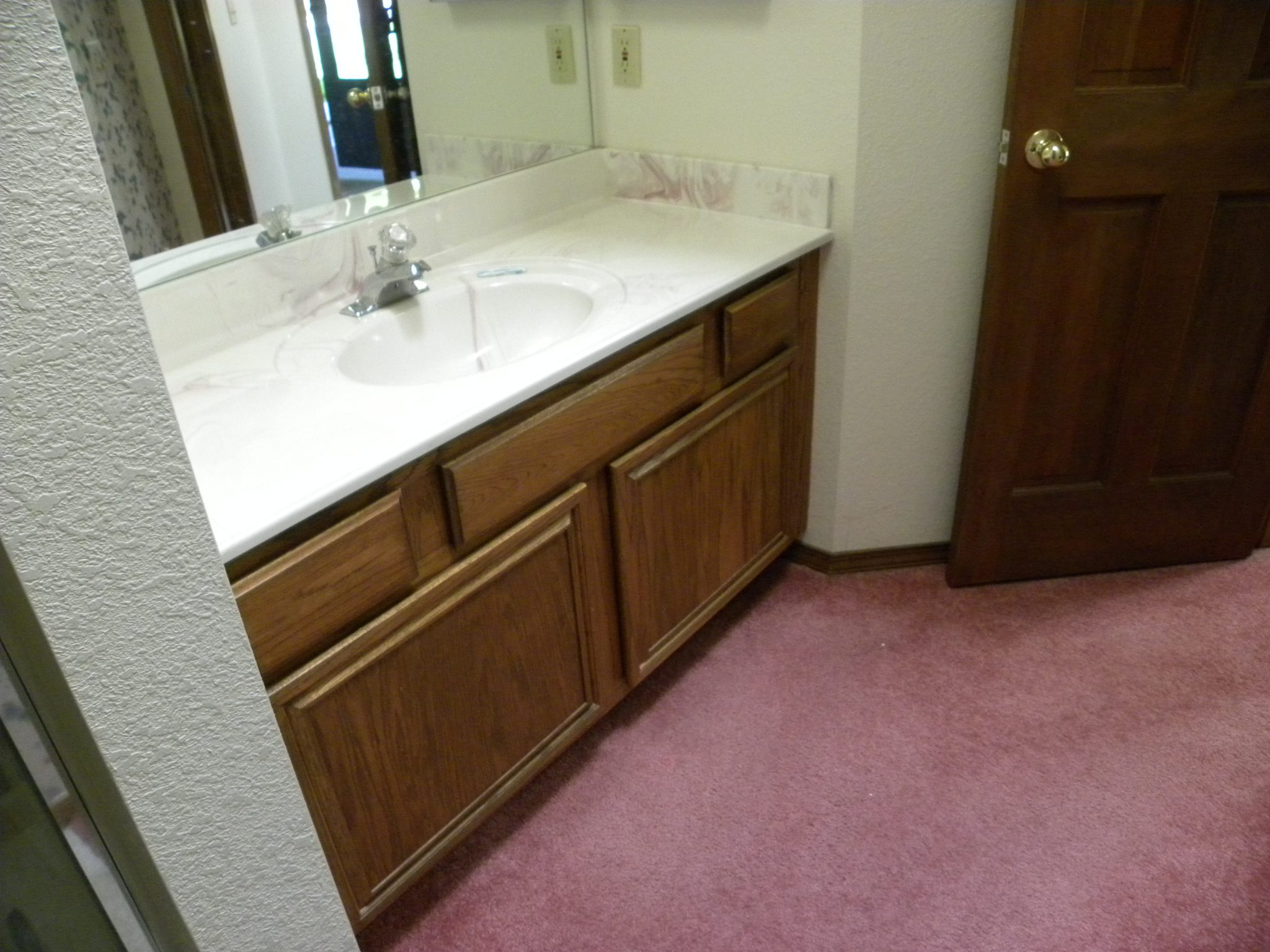 Interior shot of a residential bathroom in need of remodeling