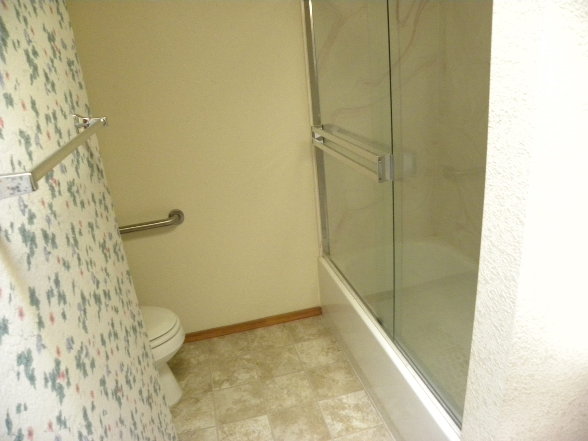 Interior shot of a residential bathroom that is ready to be remodeled